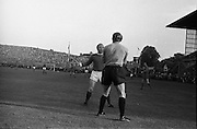 Waterford FC vs Manchester United at Lansdowne Road..1968..18.09.1968..09.18.1968..18th September 1968..Waterford FC as champions of the league of Ireland drew Manchester United, the European Champions,in the first round of this years competition.The Waterford team was as follows: Peter Thomas, Peter Bryan, Noel Griffin, Vinny Maguire, Jackie Morley, Jimmy McGeough, Al Casey, Alfie Hale, John O'Neill, Shamie Coad and Johnny Matthews. Manchester United won the tie 3 -1 with Denis Law being the man of the match..Alex Stepney,Tony Dunne,Francis Burns,Paddy Crerand,.Bill Foulkes,Nobby Stiles,George Best,Denis Law,.Bobby Charlton,David Sadler,Brian Kidd were the starting eleven for United...Nobby Stiles is pictured confronting Peter Thomas in the Waterford goalmouth.