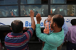 August 14, 2017 - Khan Younis, Gaza Strip, Palestinian Territory - Palestinian Muslim pilgrims wave towards their relatives before leaving for the annual haj pilgrimage to the holy city of Mecca, in Khan Younis in the southern Gaza Strip.  (Credit Image: © Ashraf Amra/APA Images via ZUMA Wire)