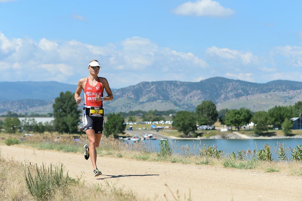 Female pro Helle Frederiksen on the run course during the 2014 Boulder Peak Triathlon. <br />