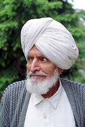 Portrait of elderly man with beard wearing turban,