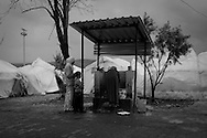 Using one of the few washing resources available, Syrians was crockery inside Reyhanli refugee camp a few kilometers away from the Syrian border. Reyhanli, Hatay, Turkey. 14th March 2012 ENN Photo/Bradley Secker