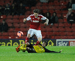 Bristol City's Aden Flint  is challenged by Watford's Fernando Forestieri - Photo mandatory by-line: Dougie Allward/JMP - Tel: Mobile: 07966 386802 14/01/2014 - SPORT - FOOTBALL - Vicarage Road - Watford - Watford v Bristol City - FA Cup - Third Round - replay