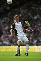 Photo: Andrew Unwin.<br /> Hearts v Gretna. Tennants Scottish Cup Final. 13/05/2006.<br /> Gretna's Ryan McGuffie competes bravely with Hearts' Rudi Skacel.