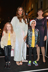 Singer LEONA LEWIS with TIA PRICE and HAYDEN PRICE and ALISON NIMMO CEO of The Crown Estates at the Quintessentially Foundation and The Crown Estate's Fayre of St.James' on 27th November 2014.  The evening started with a christmas concert at St.James's Church, Piccadilly.  Following the concert singer Leona Lewis switched on the Jermyn Street Christmas lights and then guests had a party at the newly refurbished Quaglino's, 16 Bury Street, London