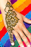 CHEFCHAOUEN, MOROCCO - 27th APRIL 2016 - Henna tattoo with floral decorative patterns on a tourists hand in Chefchaouen - the blue city - Rif Mountains, Northern Morocco.