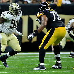 Aug 26, 2016; New Orleans, LA, USA;  New Orleans Saints defensive tackle Nick Fairley (90) pass rushes against Pittsburgh Steelers guard Ramon Foster (73) during the first half of a preseason game at Mercedes-Benz Superdome. Mandatory Credit: Derick E. Hingle-USA TODAY Sports