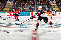 KELOWNA, BC - NOVEMBER 1: Jack Sander #17 of the Prince George Cougars passes the puck from center ice against the Kelowna Rockets  at Prospera Place on November 1, 2019 in Kelowna, Canada. (Photo by Marissa Baecker/Shoot the Breeze)