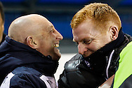 Ian Holloway Manager of Millwall and Neil Lennon Manager of Bolton Wanderers enjoy a joke before the Sky Bet Championship match at The Den, London<br /> Picture by David Horn/Focus Images Ltd +44 7545 970036<br /> 19/12/2014