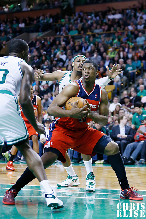 07 April 2013: Washington Wizards power forward Kevin Seraphin (13) secures the ball during the Boston Celtics 107-96 victory over the Washington Wizards at the TD Garden, Boston, Massachusetts, USA.