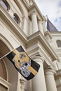 The New Orleans Saints football team flag flies from St. Louis Cathedral