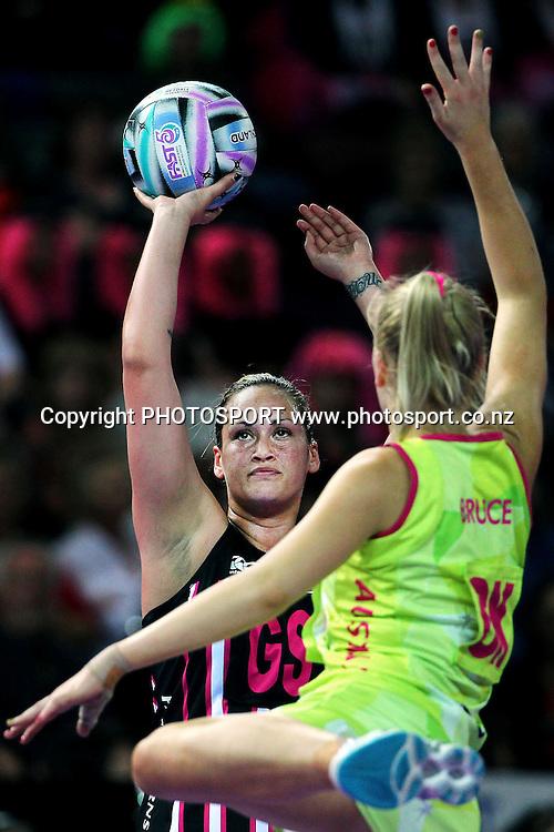 Catherine Latu of New Zealand shoots against Courtney Bruce of Australia. Fast5 Netball World Series, New Zealand v Australia at Vector Arena, Auckland, New Zealand. Friday 8th November 2013. Photo: Anthony Au-Yeung / photosport.co.nz