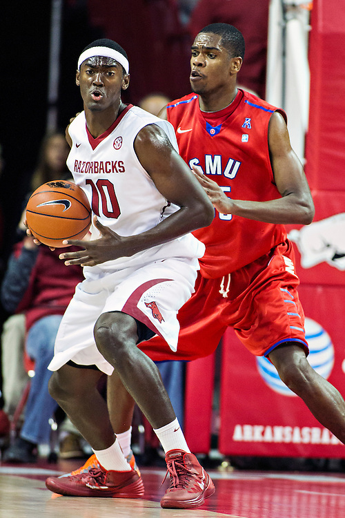 FAYETTEVILLE, AR - NOVEMBER 18:  Bobby Portis #10 of the Arkansas Razorbacks with the ball while being defended by Markus Kennedy #5 of the SMU Mustangs at Bud Walton Arena on November 18, 2013 in Fayetteville, Arkansas.  The Razorbacks defeated the Mustangs 89-78.  (Photo by Wesley Hitt/Getty Images) *** Local Caption *** Bobby Portis; Markus Kennedy