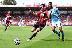Harry Arter of Bournemouth battles for the ball with Raheem Sterling of Manchester City - Mandatory by-line: Alex James/JMP - 26/08/2017 - FOOTBALL - Vitality Stadium - Bournemouth, England - Bournemouth v Manchester City - Premier League