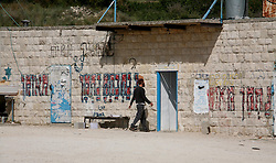 SifSufa - May 5th,  2008 -An Israeli  man  walks into a building which used be part of the village Safsaf , the middle building is now where Jewish men go to  wash in a Mikveh which  is a specific type of bath designed for the purpose of ritual immersion in Judaism i Sifsufa, Northern Israel 10KM from the Lebanese border, May 5th, 2008. Picture by Andrew Parsons / i-Images