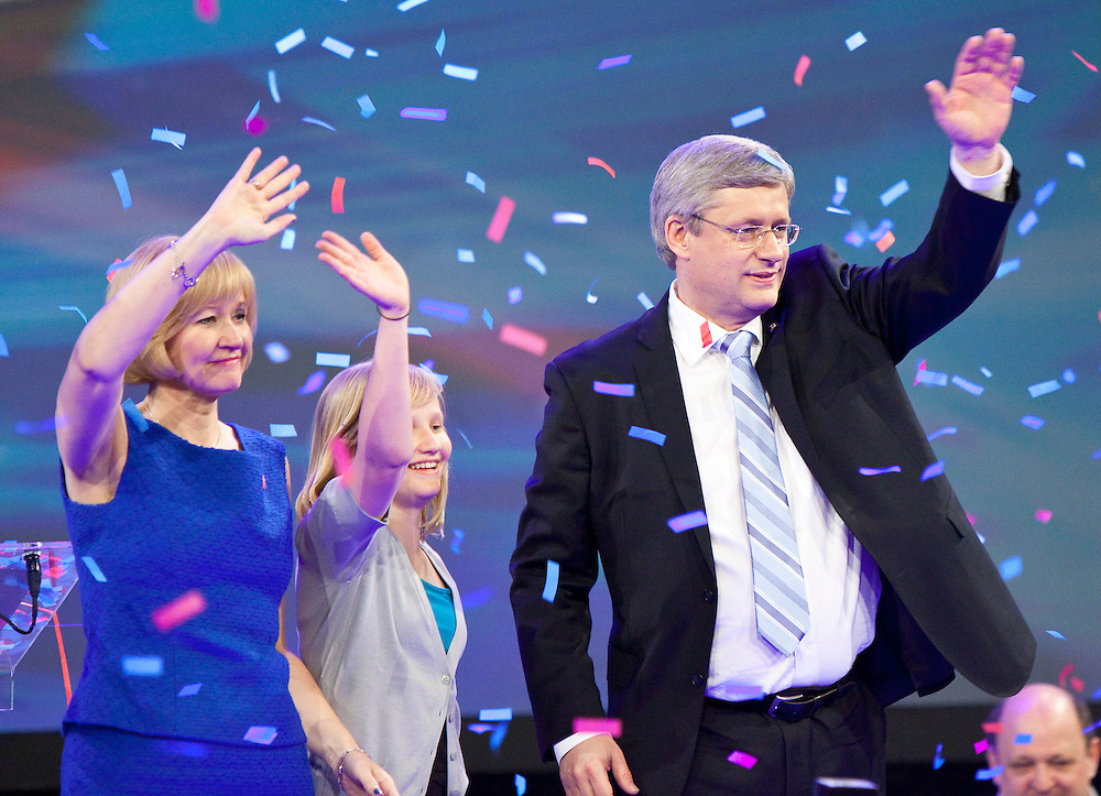 Conservative leader Stephen Harper his daughter Rachel and his wife Laureen celebrate achieving Conservative majority government in the federal election at the Telus Convention Centre in Calgary, Alberta, May 2, 2011.<br /> AFP/GEOFF ROBINS/STR