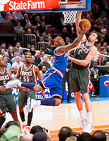 NBA superstar Carmelo Anthony makes his New York Knicks debut, seen here going to the hoop against Milwaukee's Andrew Bogut.