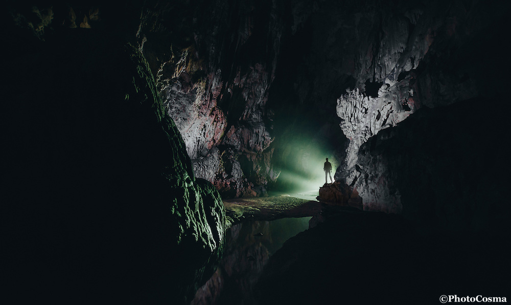 Giant cave with silhouette of man