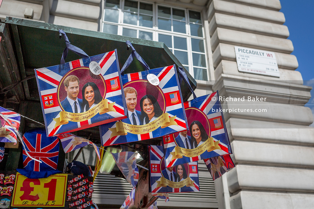 With weeks to go before the royal wedding, the faces of Prince Harry and Meghan Markle adorn merchandise that hangs from a tourist trinket kiosk on Piccadilly, on 1st May, in London, England.