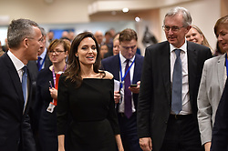 HANDOUT - L-R : NATO Secretary General Jens Stoltenberg, Special Envoy for the United Nations High Commissioner for Refugees (UNHCR), Angelina Jolie and Permanent Representative of Denmark to NATO, Michael Zilmer-Johns seen at NATO headquarters in Brussels, Belgium, as Angeline Jolie visited the Organisation on January 31, 2018. Photo by NATO via Balkis Press/ABACAPRESS.COM