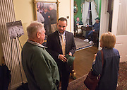 Bing Carlson, left, and Jane Carlson, right, talk to Assistant Coach J.J Crew, middle, during the 1960s hockey alumni reunion at the Konneker Alumni House on September 30, 2016.