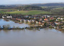 © Licensed to London News Pictures. 21/12/2019. Pulborough, UK. Flood water fills fields south of Pulborough, West Sussex after the River Arun burst its banks and flooded local businesses and farm land. River levels remain high after heavy overnight rain in the south where more rain is expected today. Photo credit: Peter Macdiarmid/LNP