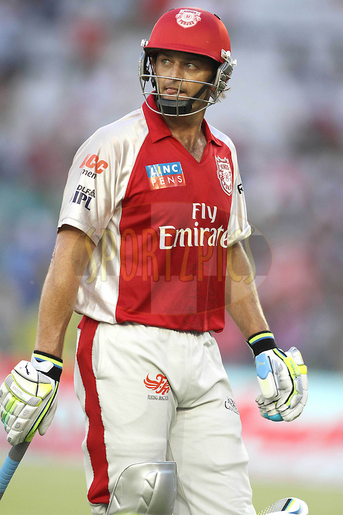 Captain Adam Gilchrist of the Kings XI Punjab after getting out during match 9 of the Indian Premier League ( IPL ) Season 4 between the Kings XI Punjab and the Chennai Super Kings held at the PCA stadium in Mohali, Chandigarh, India on the 13th April 2011..Photo by Shaun Roy/BCCI/SPORTZPICS