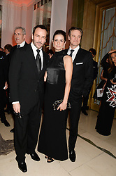 Left to right, TOM FORD, LIVIA FIRTH and COLIN FIRTH at the Harper???s Bazaar Women of the Year 2013 in association with Estée Lauder, Audemars Piguet and Selfridges & Co. held at Claridge's, Brook Street, London on 5th November 2013.