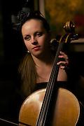 Portrait of Elena Kopytina with cello on the Celebrity Reflection.