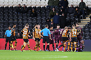 An altercation between Hull City forward Fraizer Campbell (25) and Swansea City defender Mike van der Hoorn (5) sees van der Hoorn on the ground holding his face and then both players were booked  during the EFL Sky Bet Championship match between Hull City and Swansea City at the KCOM Stadium, Kingston upon Hull, England on 22 December 2018.