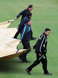 The ground staff pull on the covers during a rain affected day. - Photo mandatory by-line: Harry Trump/JMP - Mobile: 07966 386802 - 06/07/15 - SPORT - CRICKET - LVCC - County Championship Division One - Somerset v Sussex- Day Two - The County Ground, Taunton, England.