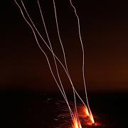 Bottle-rockets streak into the night sky at Wrightsville Beach, NC.