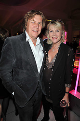 THEO & LOUISE FENNELL at the launch of Project PEP to benefit the Elton John Aids Foundation hosted by Tamara Mellon and Diana Jenkins in association with Jimmy Choo held at Selfridges, Oxford Street, London on 29th October 2009.