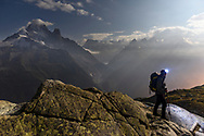 A tourist at night with view on the Aiguille Verte, Grandes Jorasses and Les Aiguilles du Chamonix, Lac Blanc, France / Impressionen beim Lac Blanc oberhalb von Chamonix, Mont-Blanc, an einem Spätsommertag im September