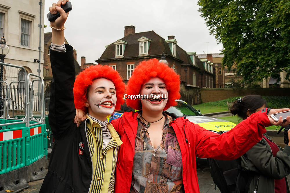 London, England, UK. 4th September 2017. Two evil, Ronald McDonald join the McD Strike UK 2017 demand MacDonald a minmum wages of £10 an hour and no to zero hours at the Parliament yard.