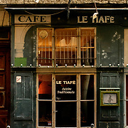 Antique cafe in the Croix-Rousse Hill, the quarter of the workers in silk, the canuts, which the revolts (1831, 1834, 1848, 1849) as the activity have left their mark in the habitat: building high and drilled many windows, where there was the jacquards, UNESCO World Heritage Site, Lyon, France, Europe