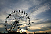ferris wheel silhouette on a sunset background