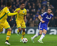 Filipe Luis of Chelsea (right) being chased down by Andre Carrillo of Sporting Clube de Portugal (centre) during the UEFA Champions League match at Stamford Bridge, London<br /> Picture by David Horn/Focus Images Ltd +44 7545 970036<br /> 10/12/2014