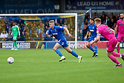 AFC Wimbledon midfielder Max Sanders (23) chasing lose ball during the EFL Sky Bet League 1 match between AFC Wimbledon and Rochdale at the Cherry Red Records Stadium, Kingston, England on 5 October 2019.