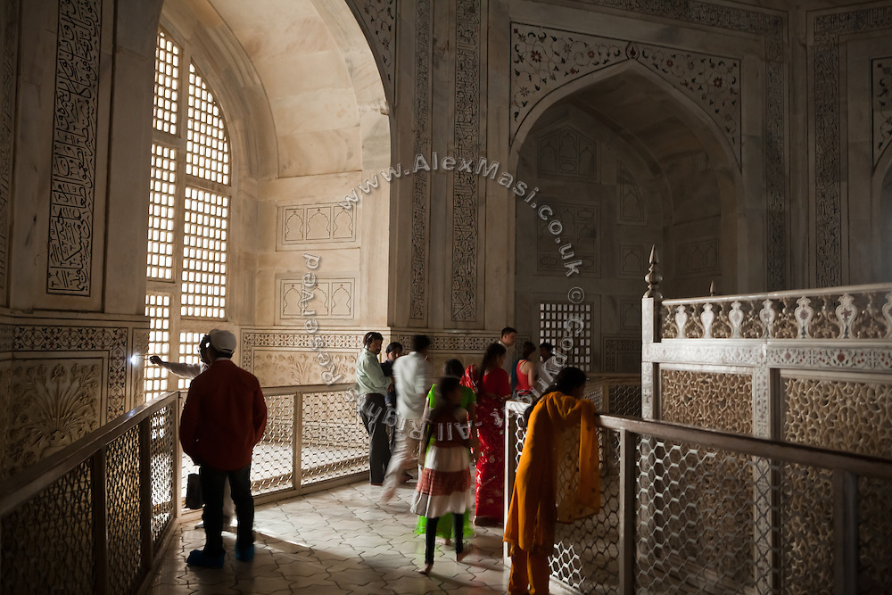 Visitors are spending time in the area containing the tombs of  Mughal emperor Shah Jahan and his third wife, Mumtaz Mahal, in the name of which the Taj Mahal mausoleum was also built and completed around the year 1653, in Agra.