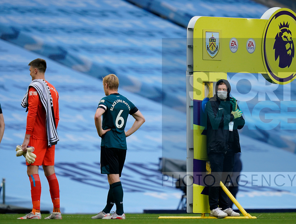 Men in masks and gloves now accompany players out onto the pitch in the post Covid19 world during the Premier League match at the Etihad Stadium, Manchester. Picture date: 22nd February 2020. Picture credit should read: Andrew Yates/Sportimage