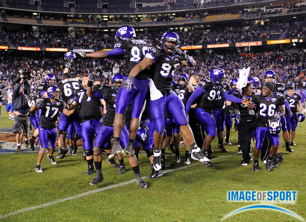 Dec 23, 2008; San Diego, CA, USA; Texas Christian Horned Frogs receiver Jimmy Young (88), left, and defensive end Jerry Hughes (98) celebrate after the Horned Frogs' 17-16 victory over the Boise State Broncos in the Poinsettia Bowl at Qualcomm Stadium.