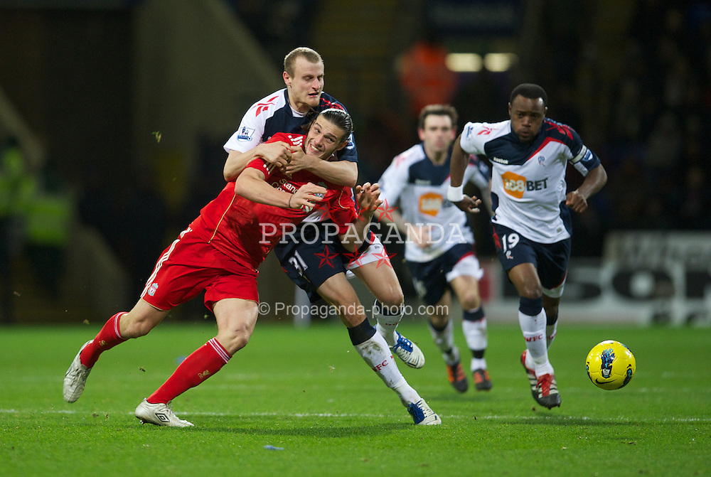 BOLTON, ENGLAND - Saturday, January 21, 2011: Liverpool's Andy Carroll in action against Bolton Wanderers' David Wheater during the Premiership match at the Reebok Stadium. (Pic by David Rawcliffe/Propaganda)