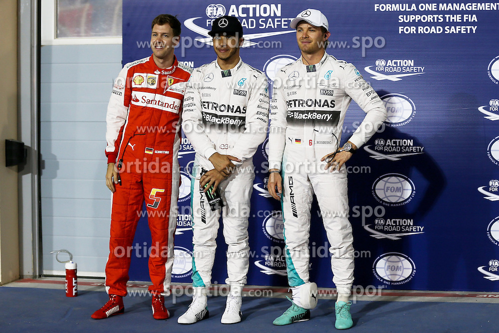 18.04.2015, International Circuit, Sakhir, BHR, FIA, Formel 1, Grand Prix von Bahrain, Qualifying, im Bild (L to R): Sebastian Vettel (GER) Ferrari, pole sitter Lewis Hamilton (GBR) Mercedes AMG F1 and Nico Rosberg (GER) Mercedes AMG F1 celebrate in parc ferme // during Qualifying of the FIA Formula One Bahrain Grand Prix at the International Circuit in Sakhir, Bahrain on 2015/04/18. EXPA Pictures &copy; 2015, PhotoCredit: EXPA/ Sutton Images/ Mirko Stange<br /> <br /> *****ATTENTION - for AUT, SLO, CRO, SRB, BIH, MAZ only*****