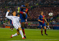 ROME, ITALY - Tuesday, May 26, 2009: Manchester United's Cristiano Ronaldo is thwarted by Barcelona's Yaya Toure during the UEFA Champions League Final at the Stadio Olimpico. (Pic by Carlo Baroncini/Propaganda)