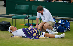 LONDON, ENGLAND - Monday, June 29, 2009: Lleyton Hewitt (AUS) receives treatment from the physiotherapist during the Gentlemen's Singles 4th Round match on day seven of the Wimbledon Lawn Tennis Championships at the All England Lawn Tennis and Croquet Club. (Pic by David Rawcliffe/Propaganda)