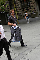 Man with laundered shirts on his way to work in the Central Business District, Sydney, Australia. January 2nd-11th 2007
