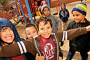 Elvira Elementary School  kindergarteners play at recess in Tucson, Arizona, USA, on February 14th, 2012, the date of the 100th birthday of the state of Arizona.