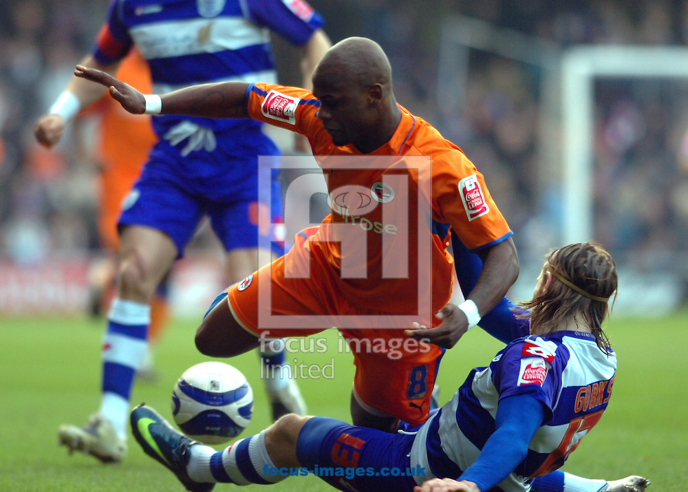 London - Saturday January 31st, 2009: Kaspars Gorkss of QPR in action against Leroy Lita of Reading during the Coca Cola Championship match at Loftus Road, London. (Pic by Focus Images)