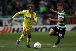 February 14, 2019 - Lisbon, Portugal - Villarreal's forward Samuel Chukwueze (L) vies with Sporting's midfielder Miguel Luis from Portugal during the UEFA Europa League Round of 32 First Leg football match Sporting CP vs Villarreal CF at Alvalade stadium in Lisbon, Portugal on February 14, 2019. (Credit Image: © Pedro Fiuza/NurPhoto via ZUMA Press)