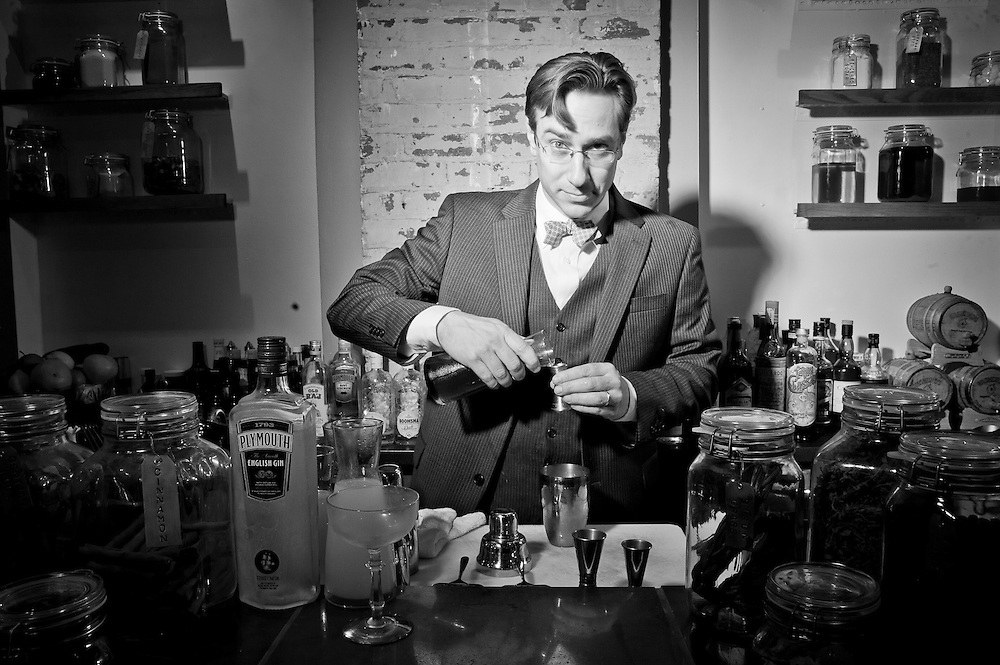 Derek Brown, the mixologist behind the Columbia Room, prepares drinks at his 7th St NW bar.  Credit: Susana Raab for The Wall Street Journal